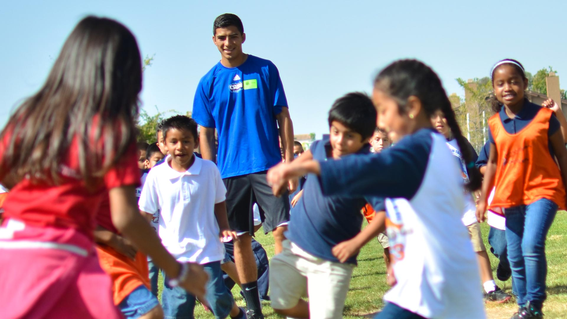 CSUSM student working with kids
