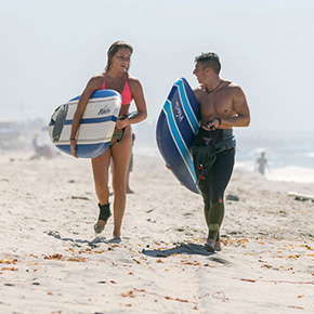 Two student surfers at the beach