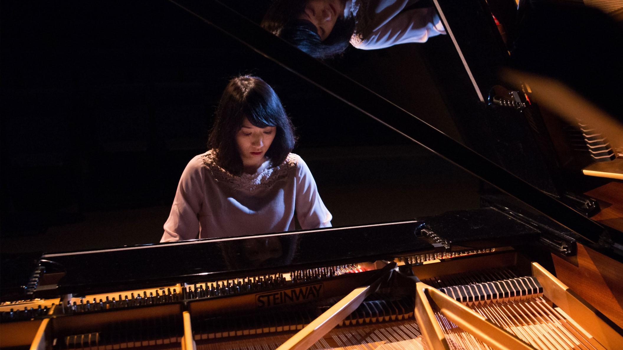 Dr Ching Ming Cheng playing the University's new Steinway D Concert Grand piano