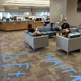 staff preparing systems for distribution with 6 feet spacing lines on carpet