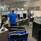 staff preparing systems for distribution
