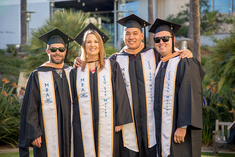 MBA students in cap and gown