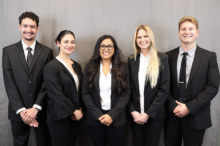 Student Consulting Services - five students in professional attire