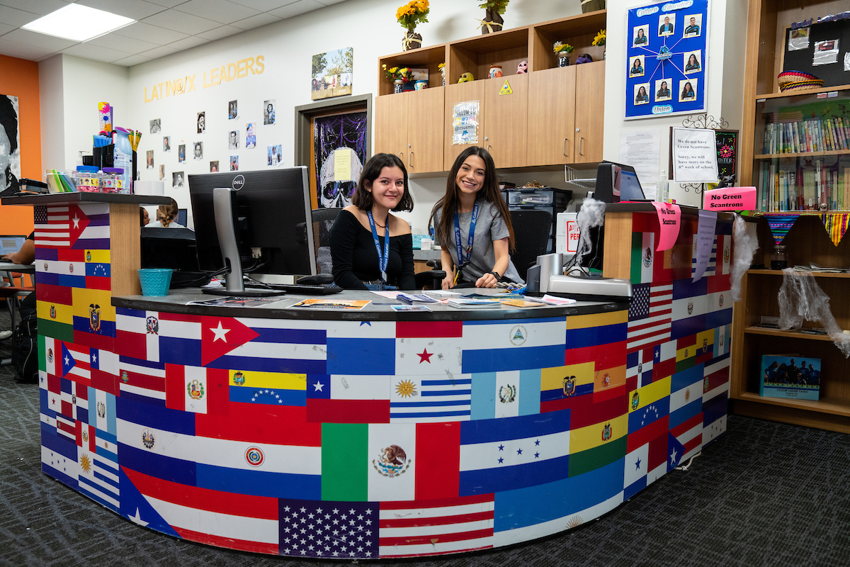 Front Desk with smiling students