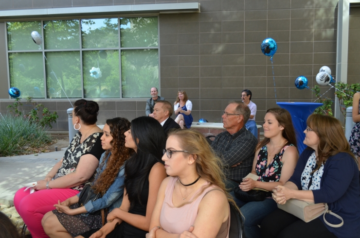 Students attending graduation reception