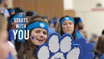 It starts with you - students with cougar spirit gear at a sports event
