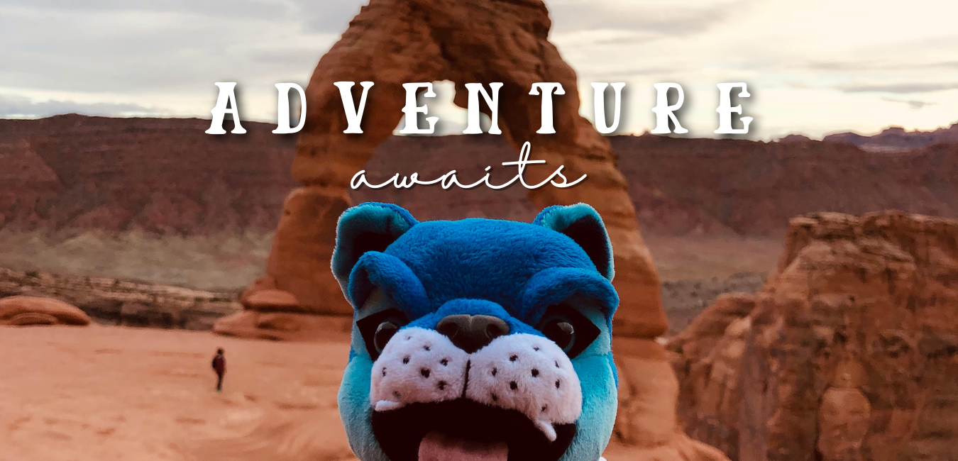 "CSUM mascot in Arches, Utah ""adventure awaits"""