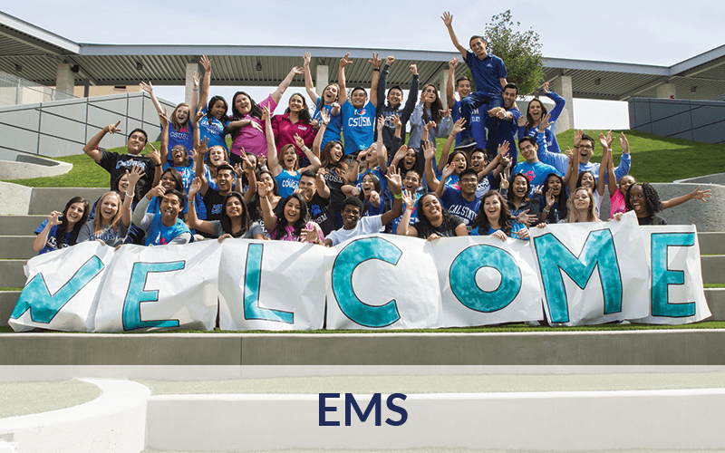 Students with Welcome Banner