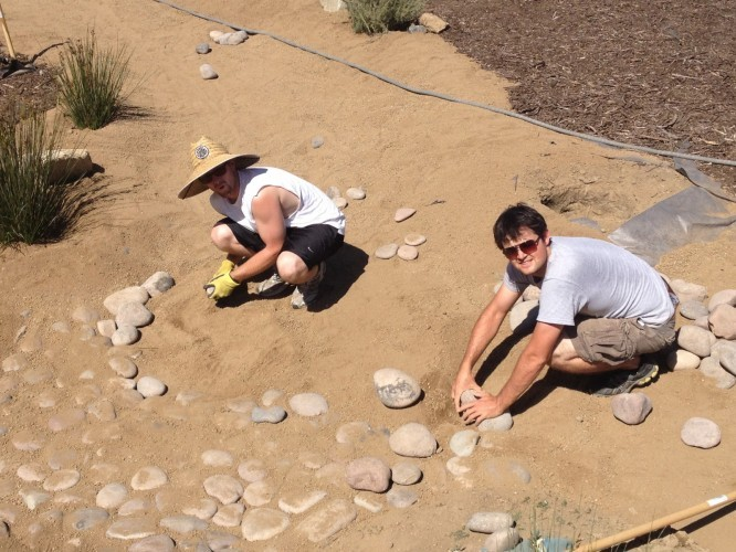 Students working in drought tollerant garden