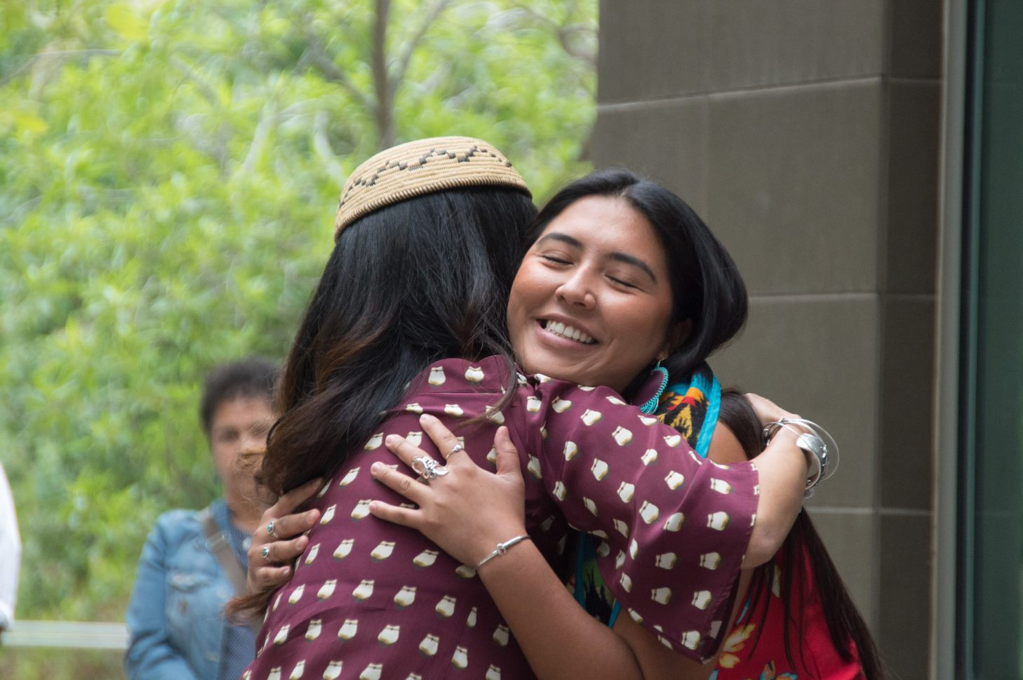 tribal student hugging tribal services staff at graduation celebration